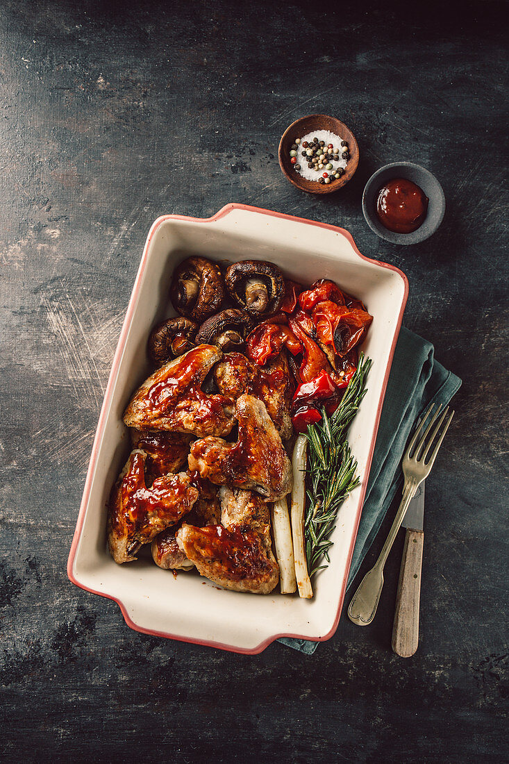 Barbecue chicken wings with grilled vegetables