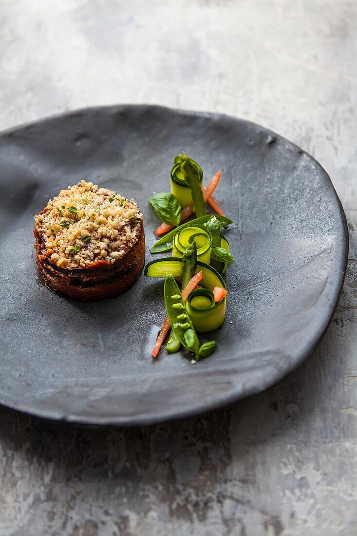 Vegan aubergine parmigiana with primaverde salad