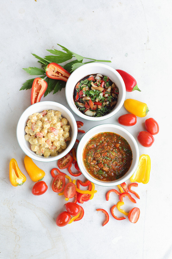 Warm chickpea dip with peppers and cheese, salsa verde and sofrito