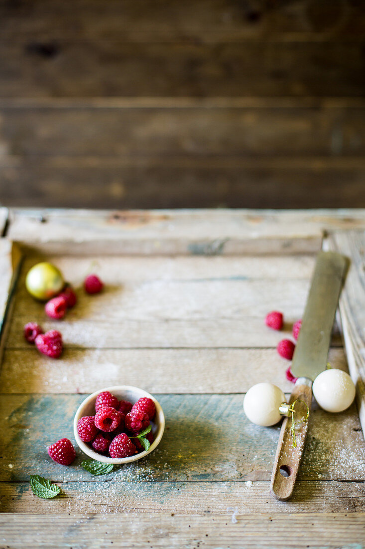Festive raspberries on a wooden baking surface