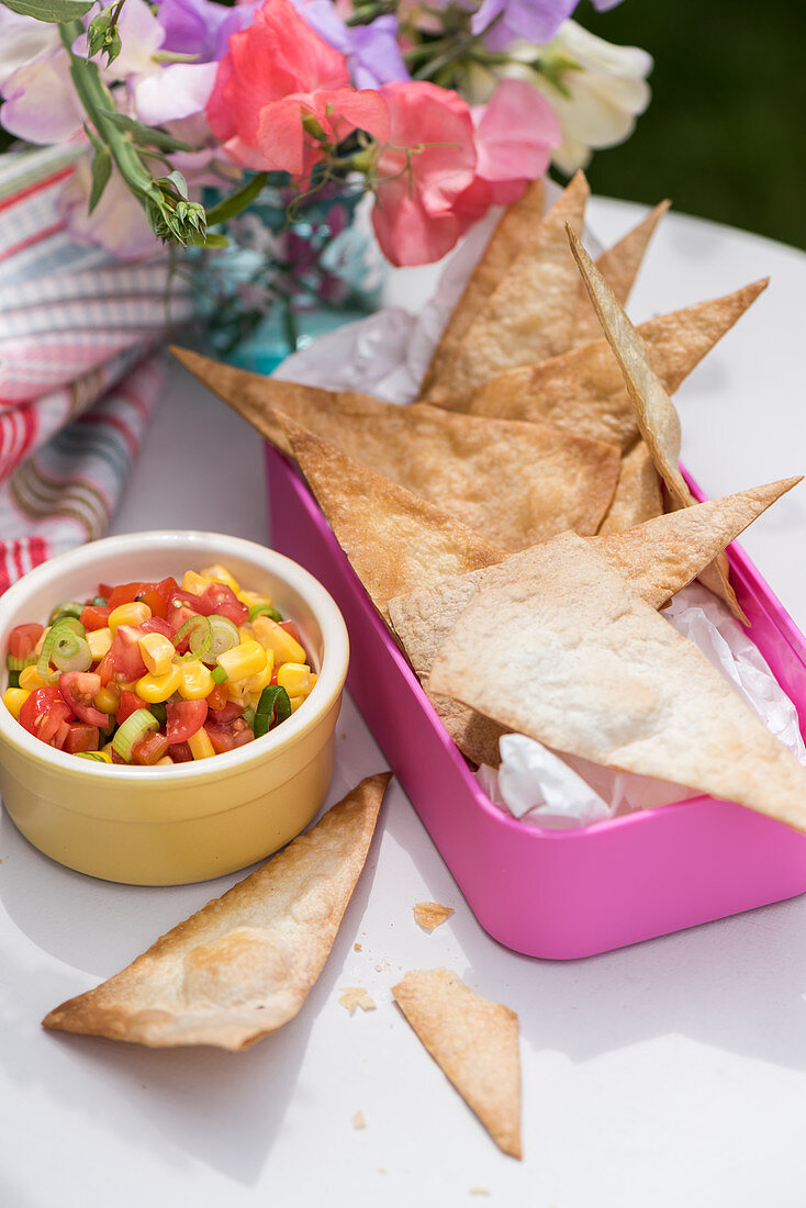 Baked tortilla chips with sweetcorn salad for a school lunch