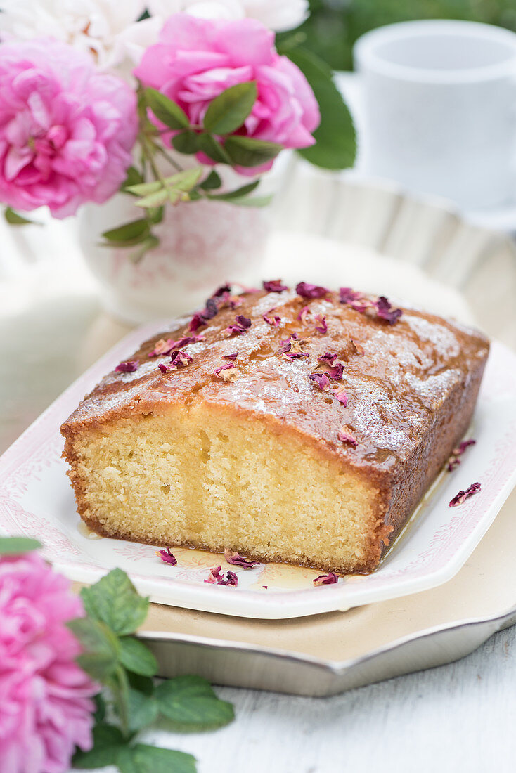 Drizzle cake with rose water and roses, sliced