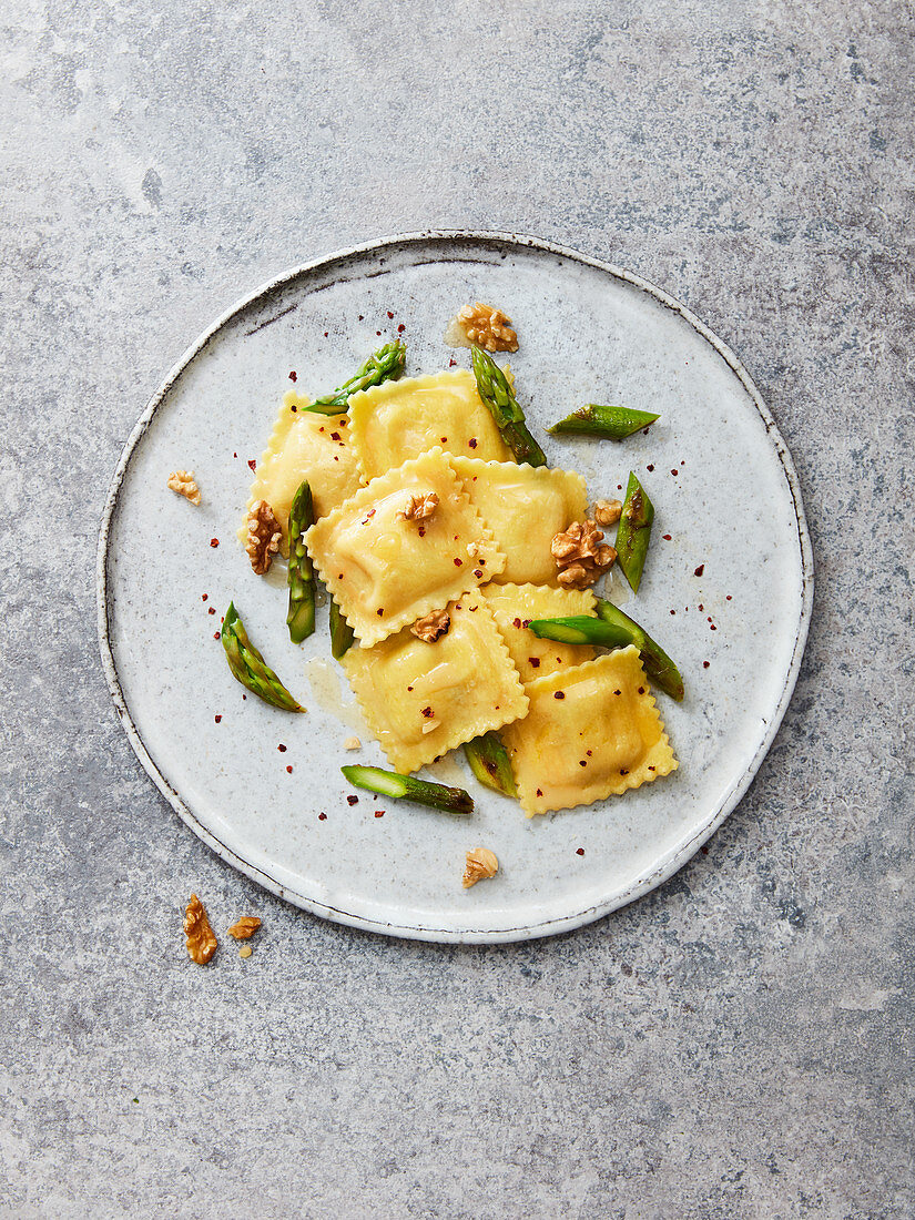Goat's cheese ravioli with green asparagus, walnuts, chilli flakes and olive oil