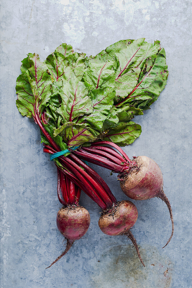 Fresh beets on a metal background