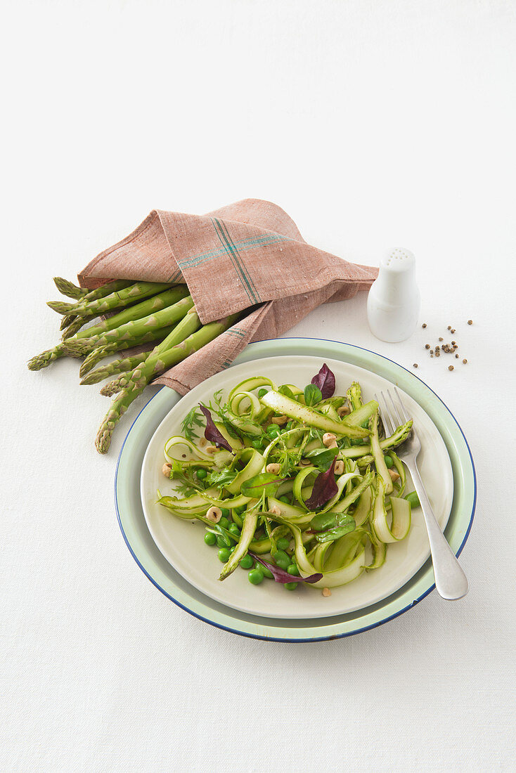 Green asparagus salad with courgette, peas and beetroot leaves