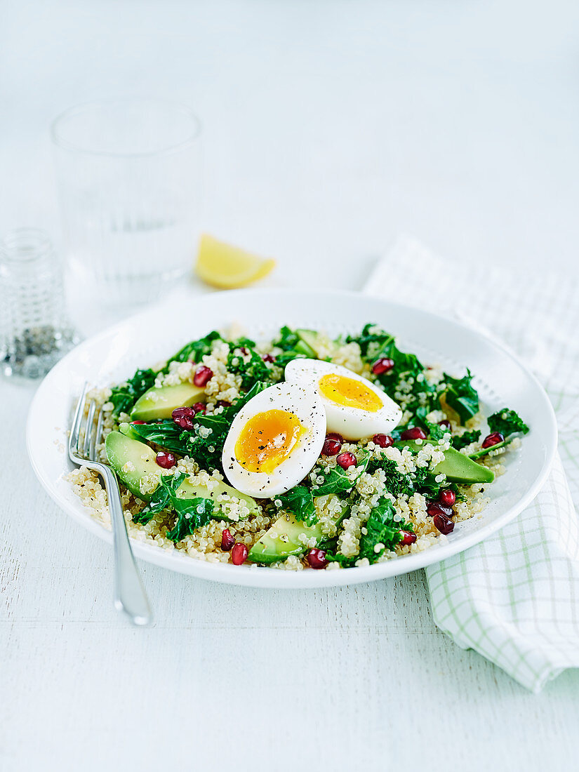 Kale and quinoa salad with avocado and egg