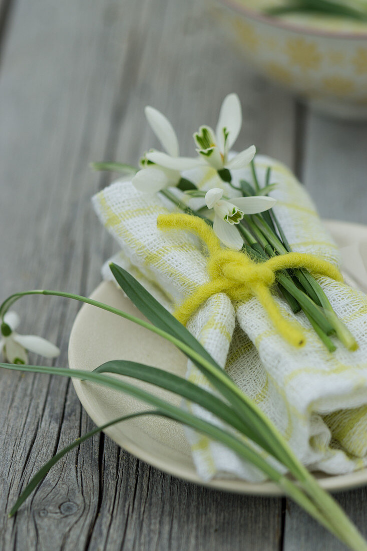 A place setting with snowdrops