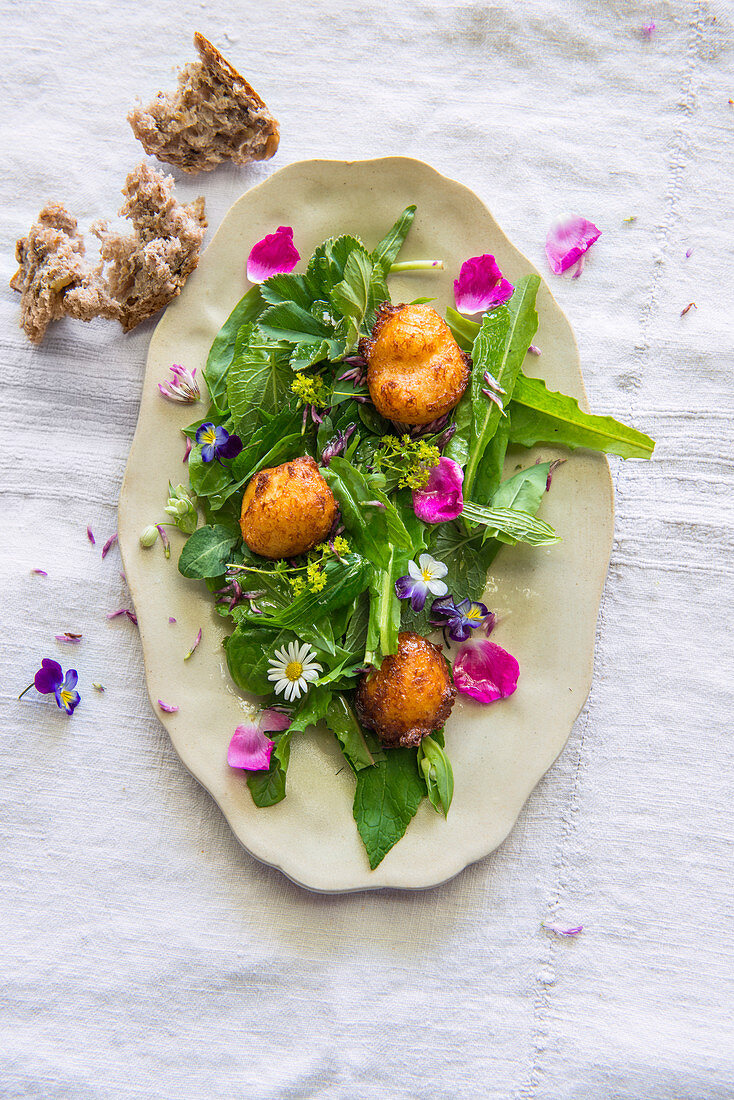 Herb and flower salad with deep-fried quark balls
