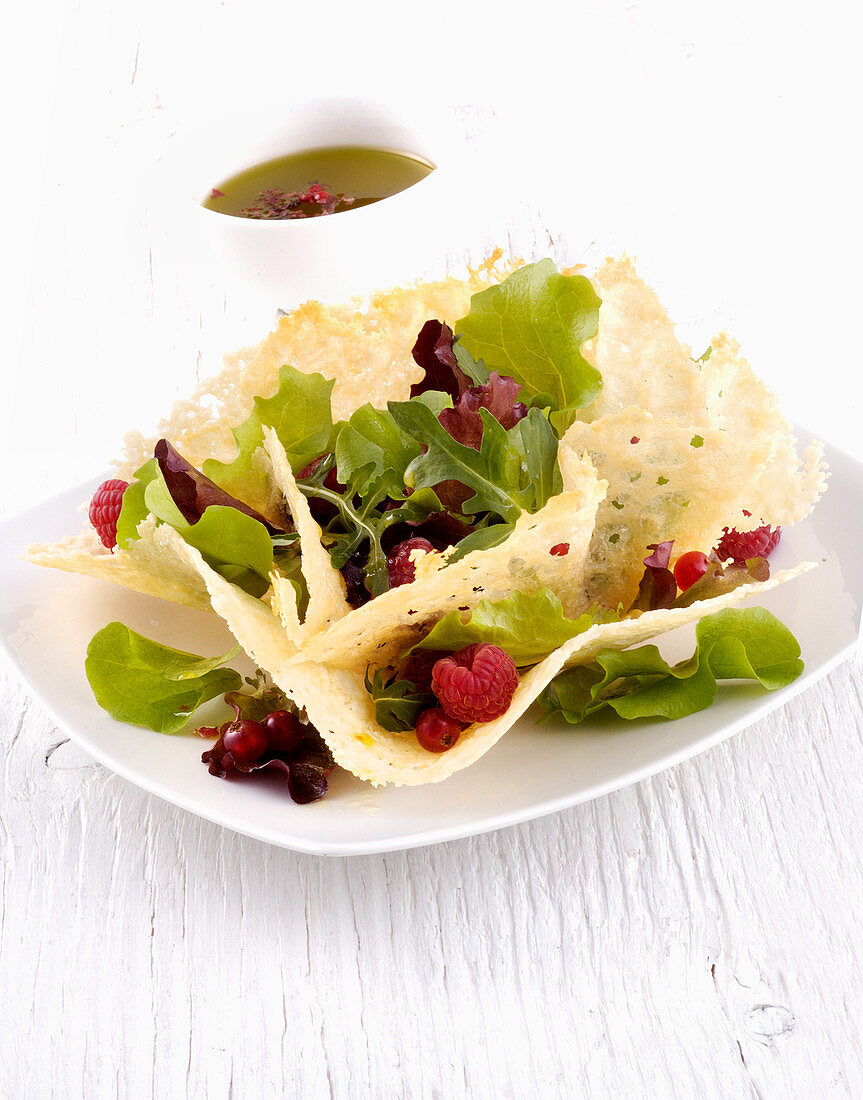 Lettuce with raspberries in a parmesan bowl