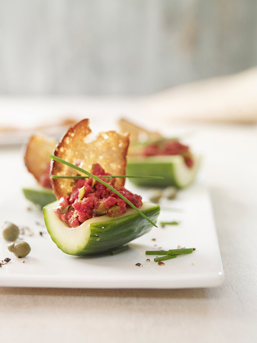 Cucumber boats with tartar and farmhouse bread crisps
