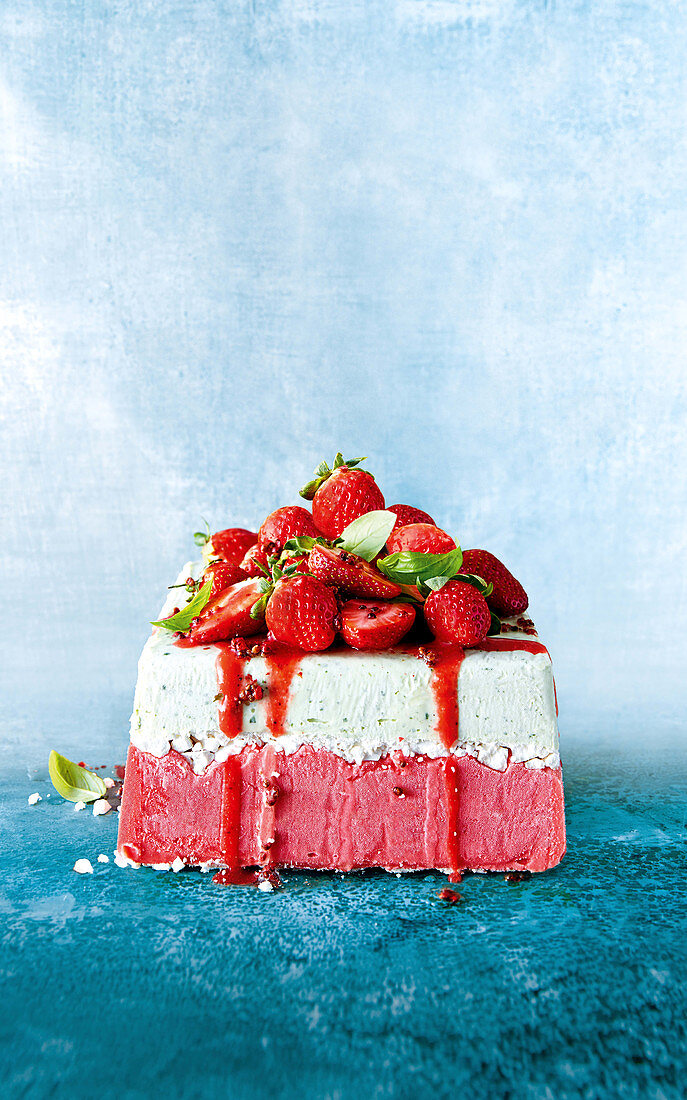 Strawberry and basil ice-cream cake with meringue and pink peppercorns