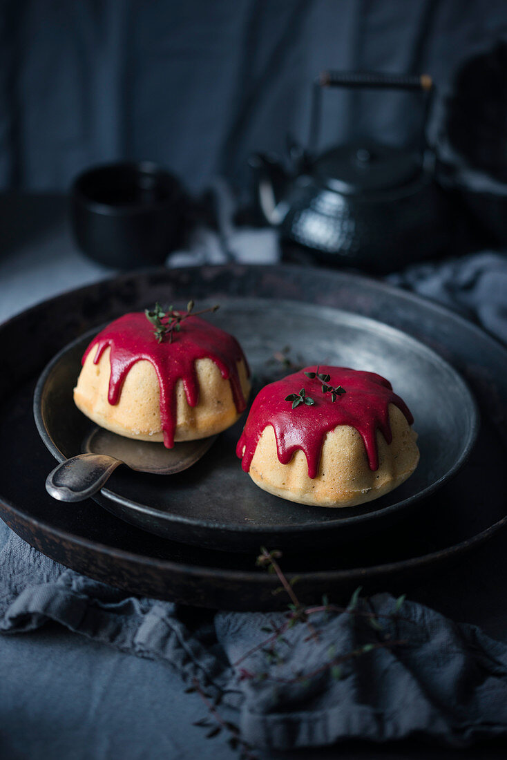 Vegan lemon and thyme cakes with a raspberry glaze