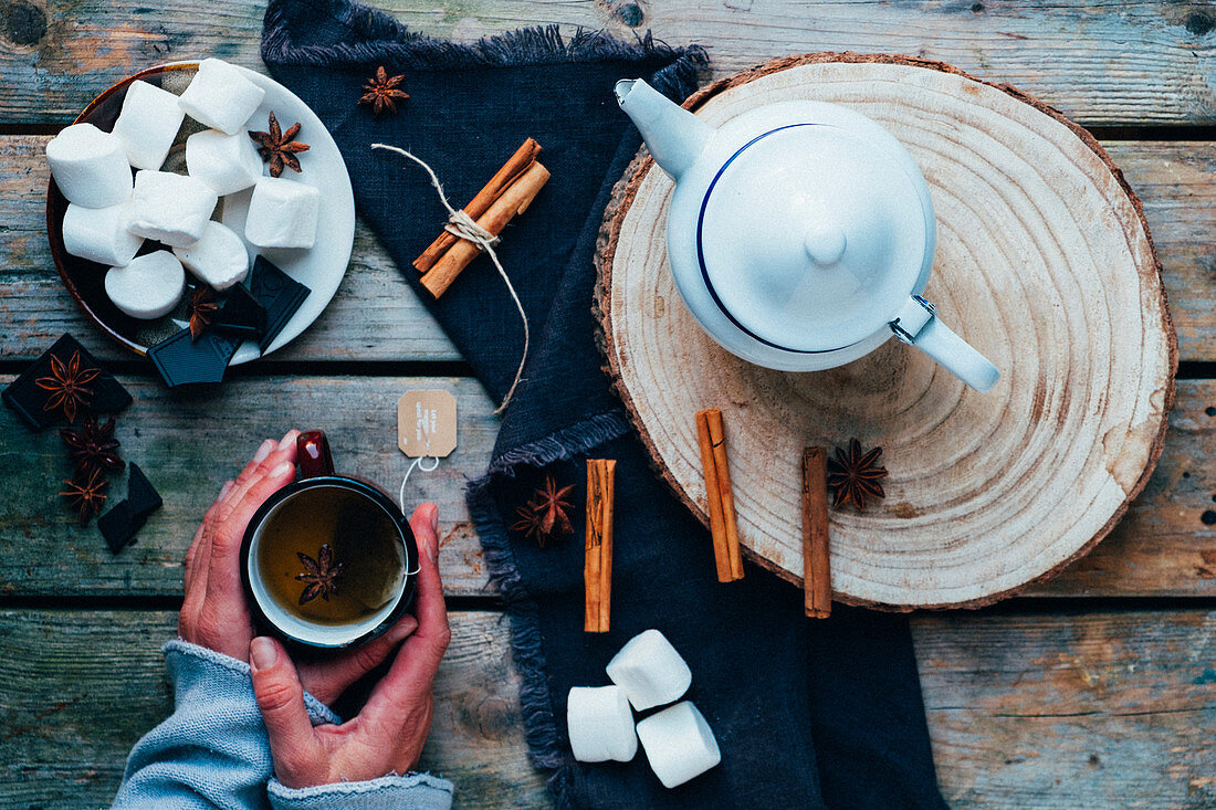 A cup of tea with marsmallows and chocolate