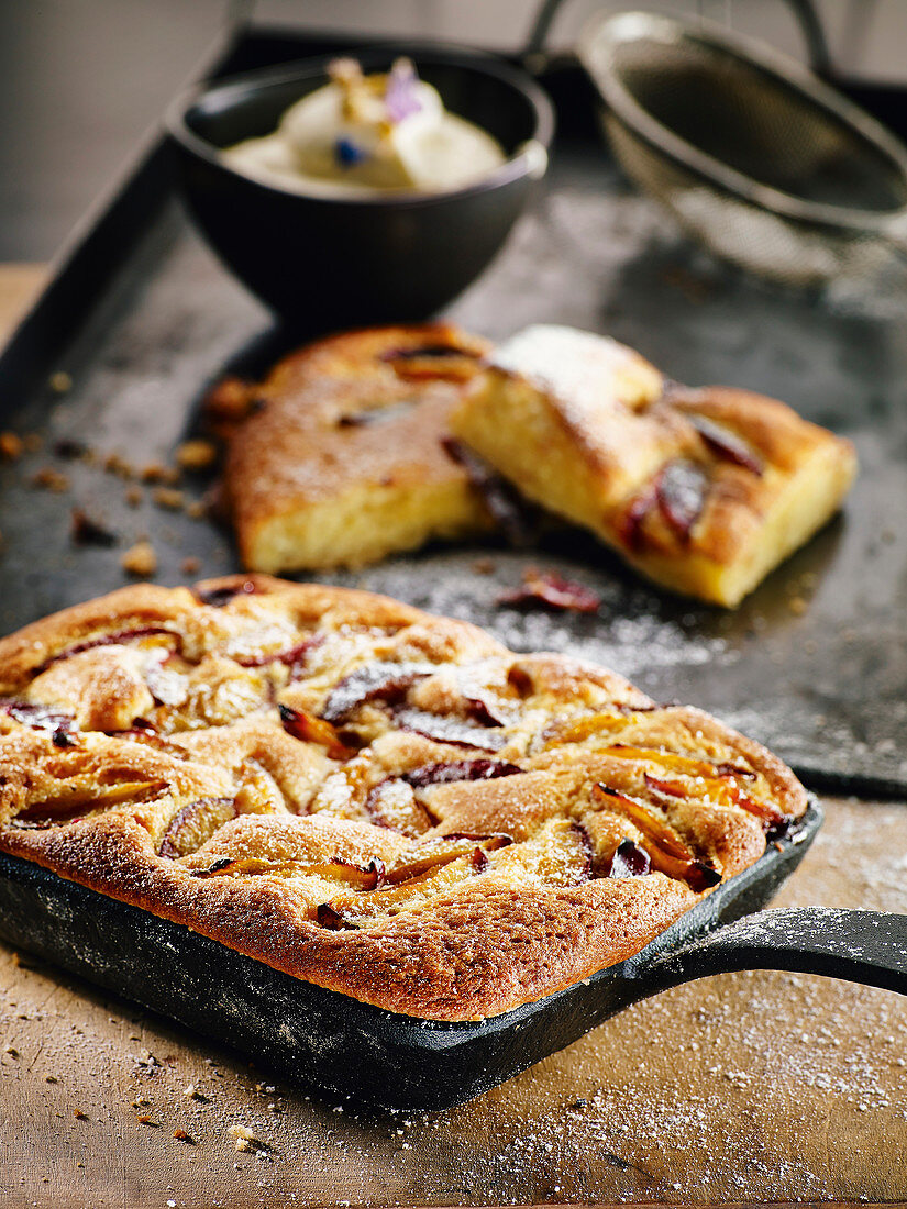 Sunken plum cake with vanilla and cinnamon sugar