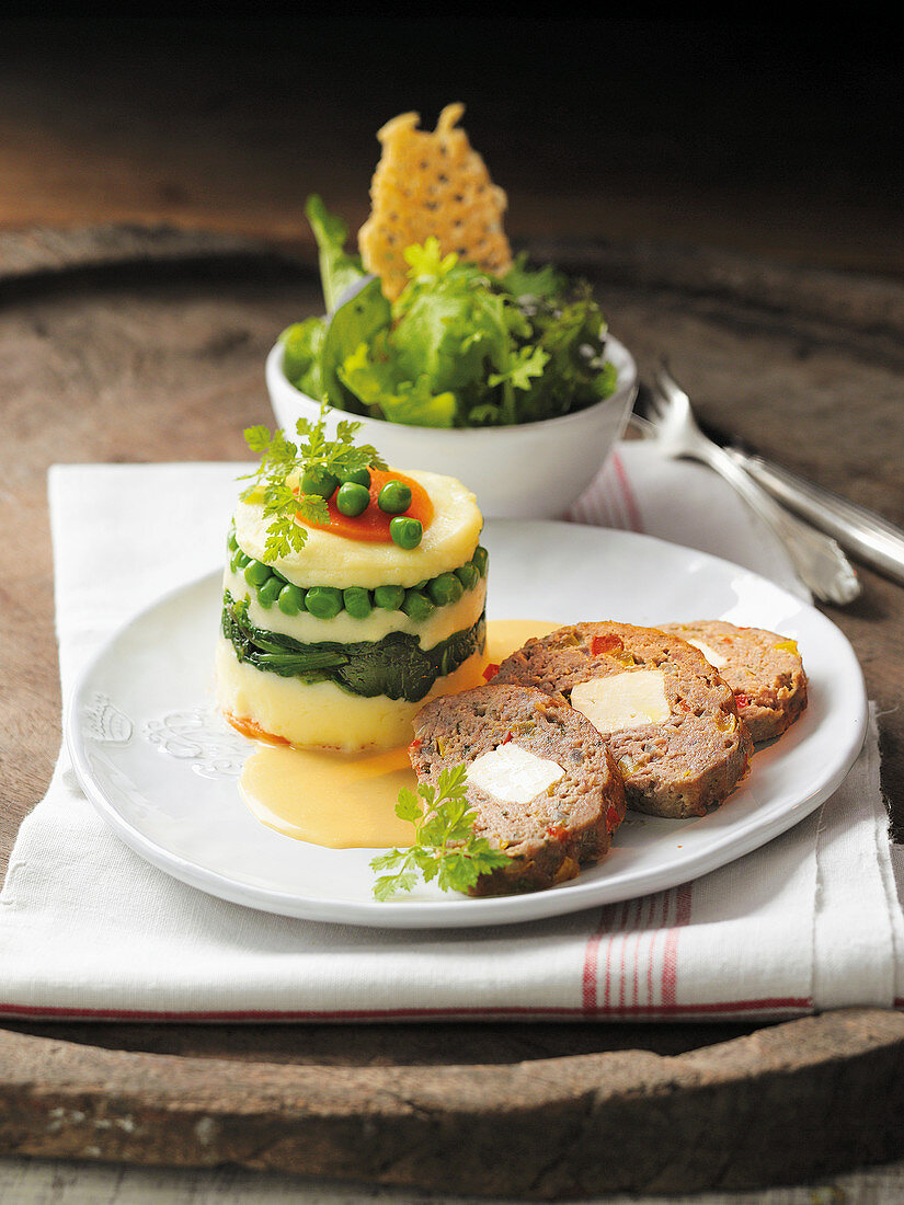 Meatloaf with potato foam and cheese crisps