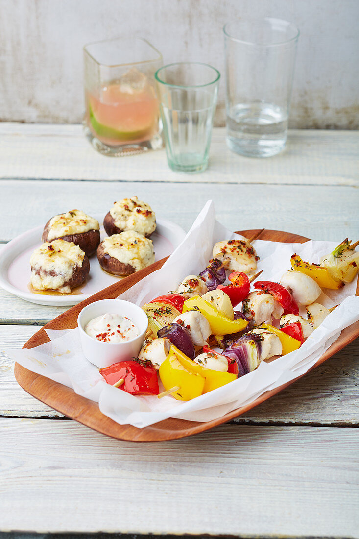 Rainbow chicken skewers with a dip