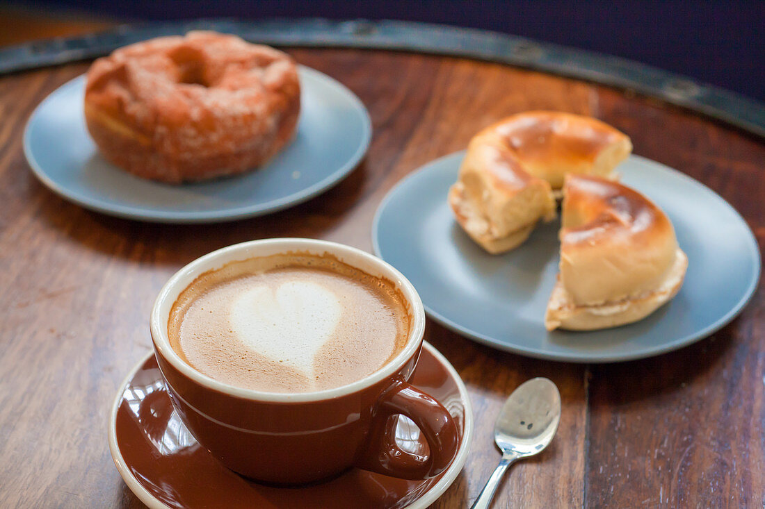 Latte, plain bagel with cream cheese and cinnamon sugar donut