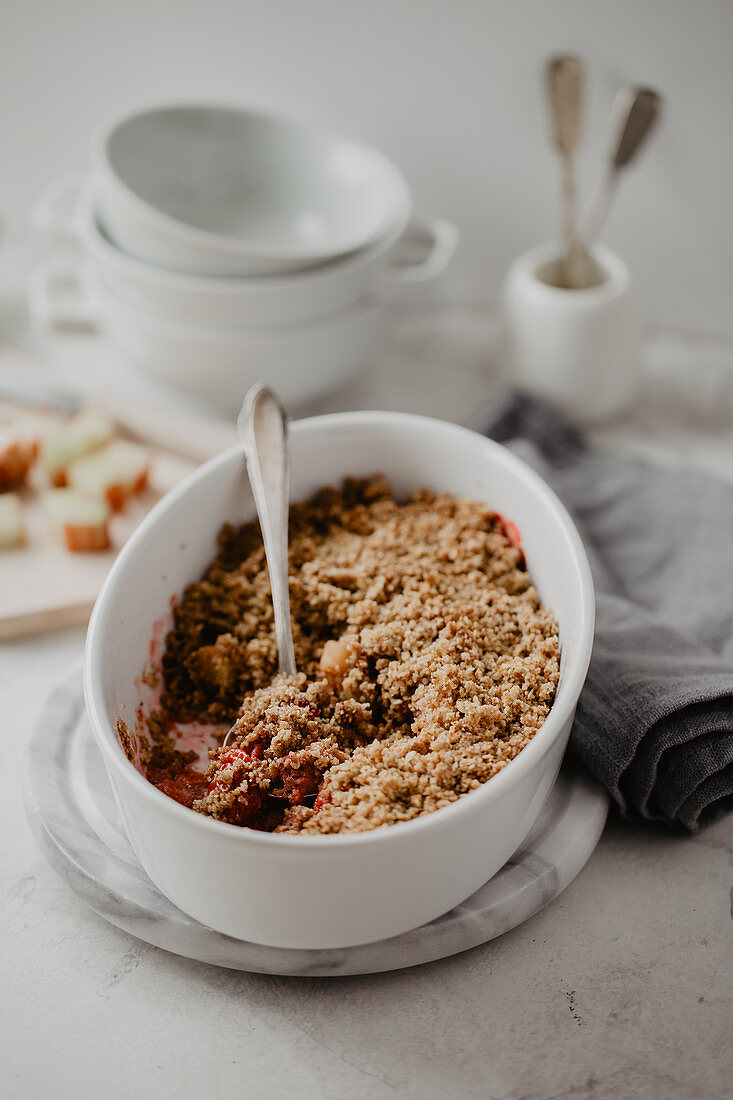 Gluten-free crumble with strawberries, rhubarb, oats, walnuts, cinnamon and coconut oil