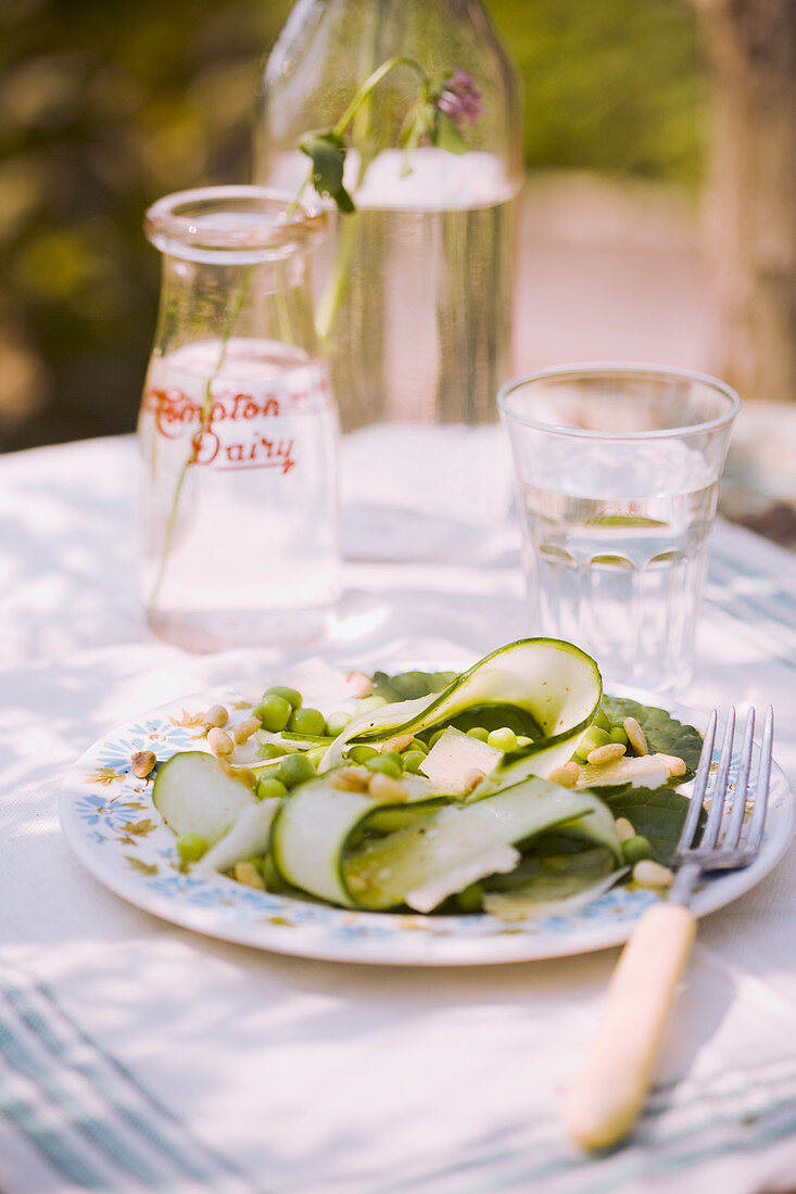 Summery zucchini and pea salad with pine nuts