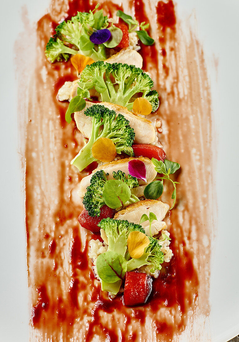 Corn fed chicken with pearl barley, broccoli and red wine peaches