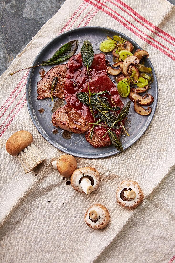 Saltimbocca with a mushroom and leek medley