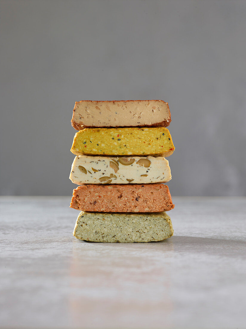 From top to bottom: basil tofu, tomato tofu, olive tofu, turmeric tofu and smoked tofu