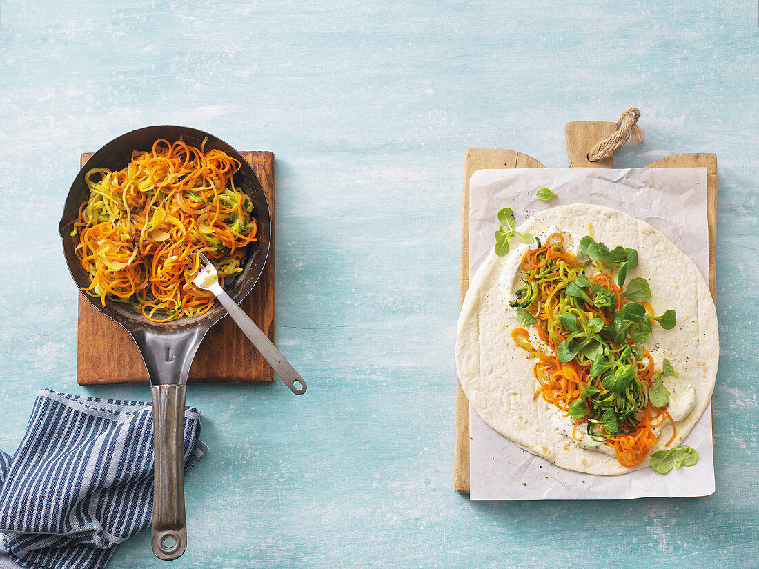 Carrot and courgette spiral wraps being made
