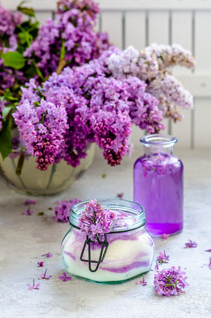 Sugar with lilac blossoms, lilac flower syrup and lilac blossoms