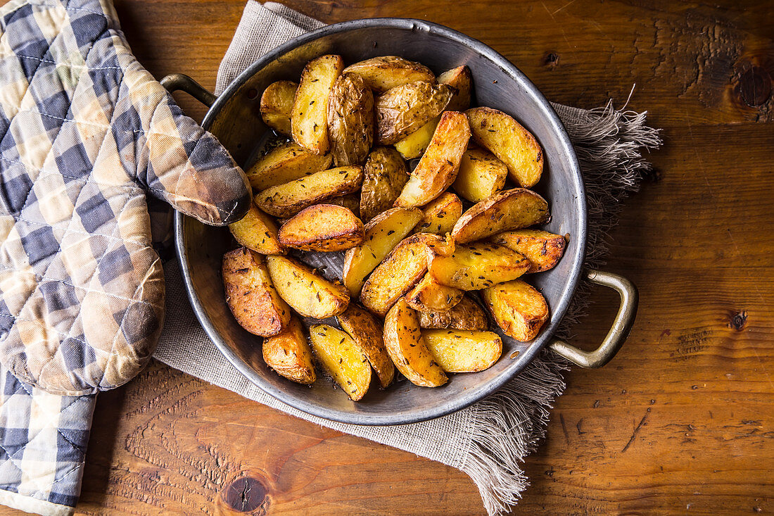 Roasted potato wedges with caraway seeds (top view)