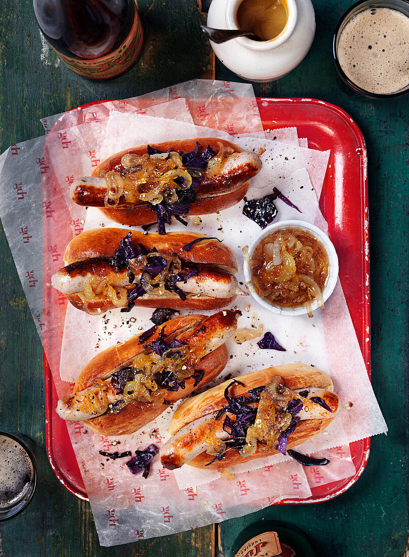 Hot dogs with red cabbage and caramelized onions