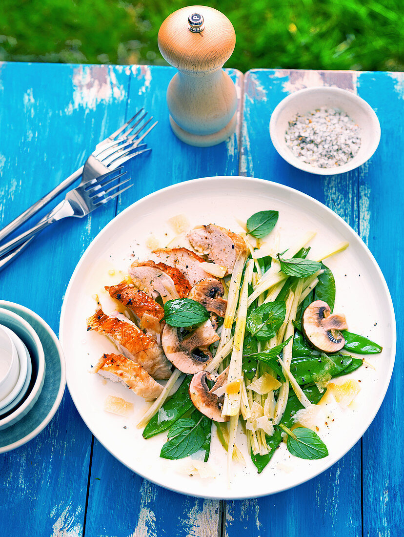 Fried chicken breast with celery, mushrooms, mange tout and mint