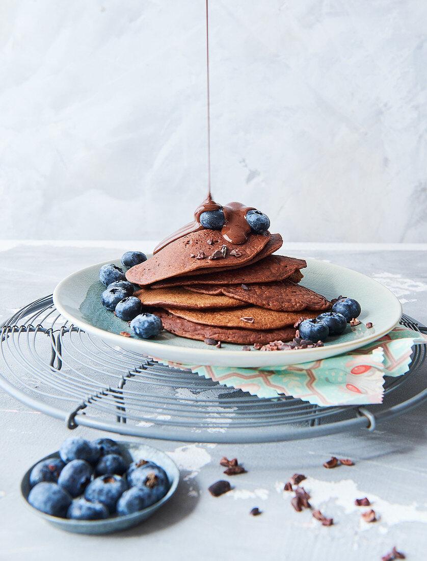 Sugar-free vegan chocolate pancakes with blueberries