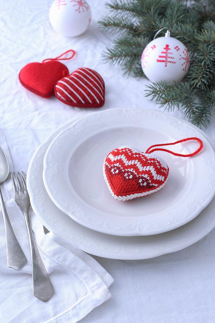 Heart-shaped fabric Christmas tree decoration on plate