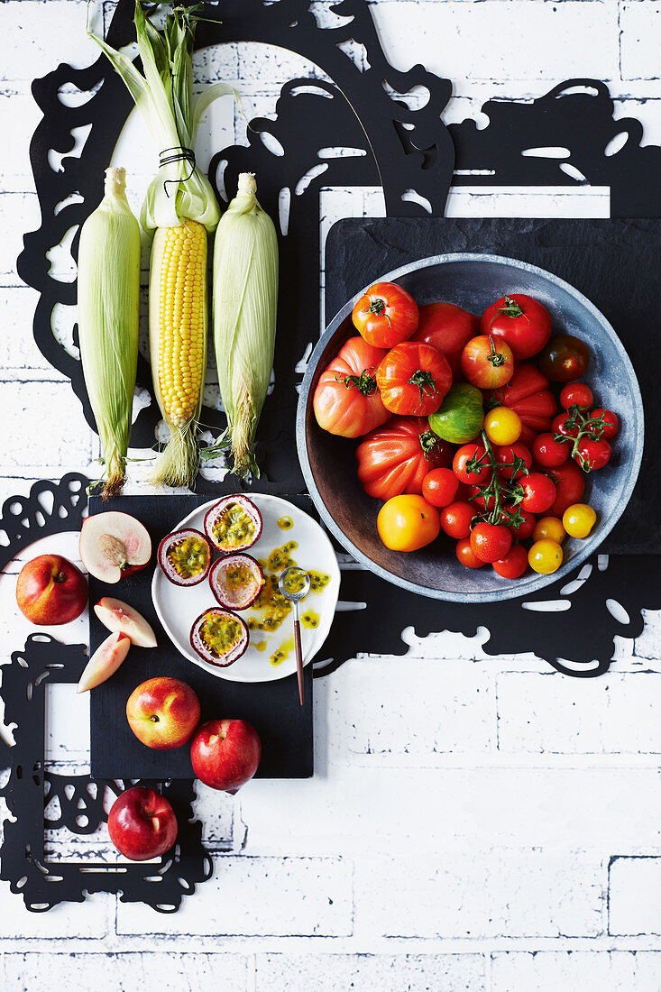 Corn, nectarines, passions fruits and tomatoes