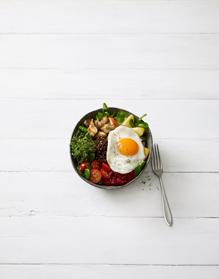 Sunny side up bowl with lentils and a fried egg