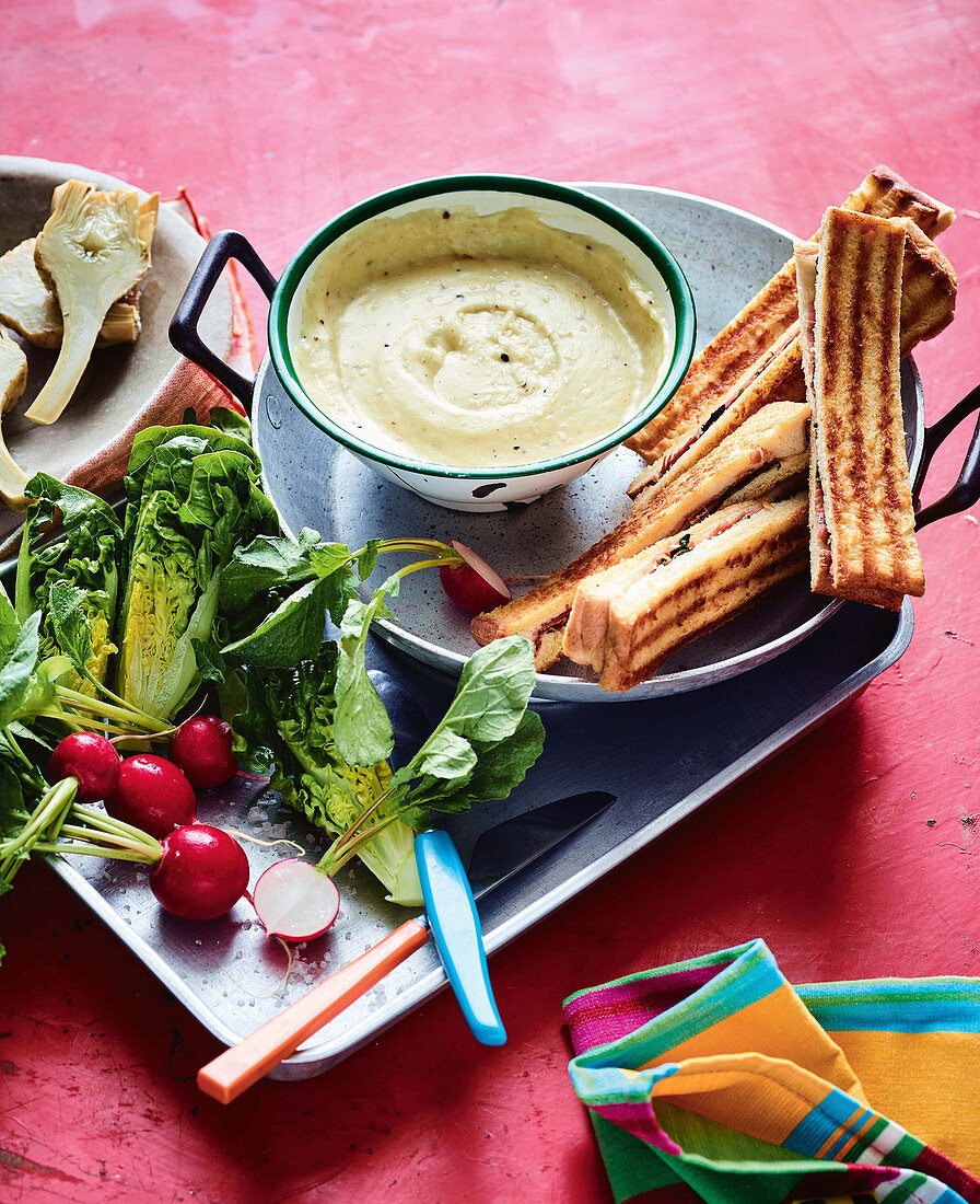 Two-cheese fondue with prosciutto toast and crudite