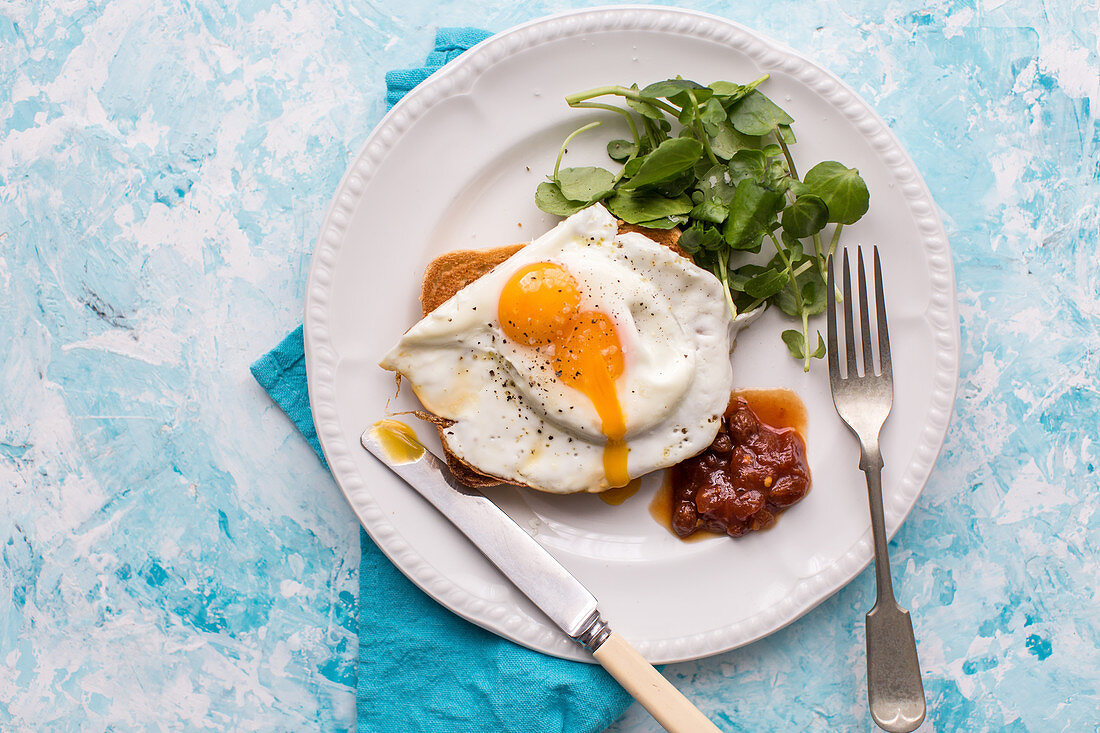 Fried Egg with watercress salad greens and tomato chutney
