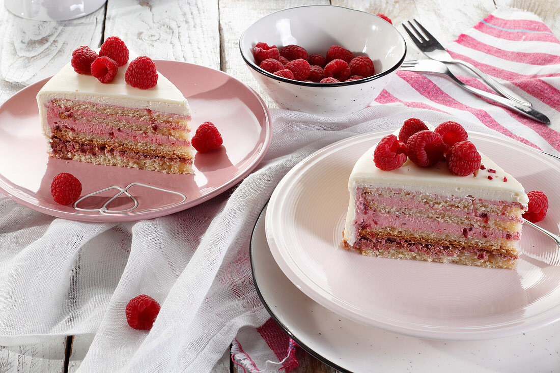 Two slices of raspberry cake