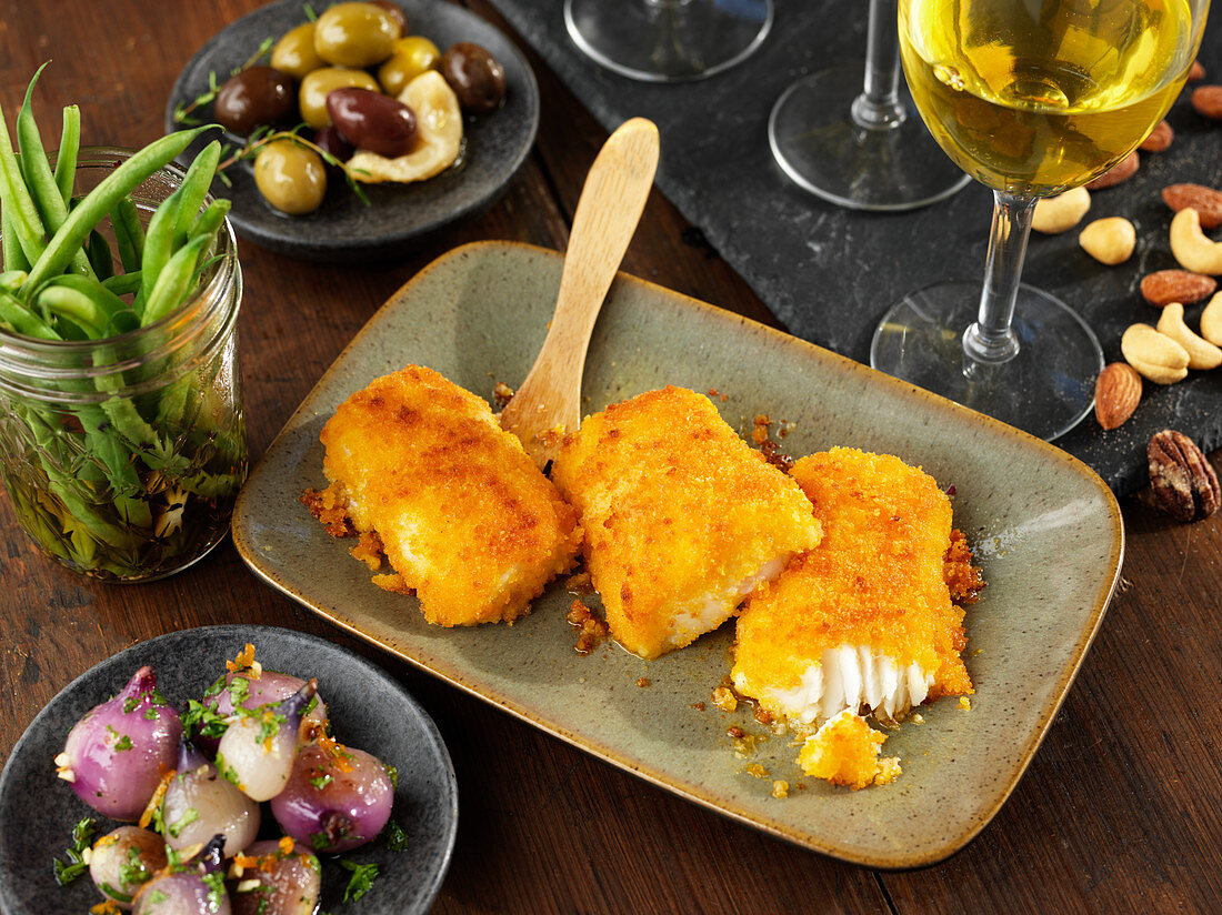 Breaded cod with marinated vegetables