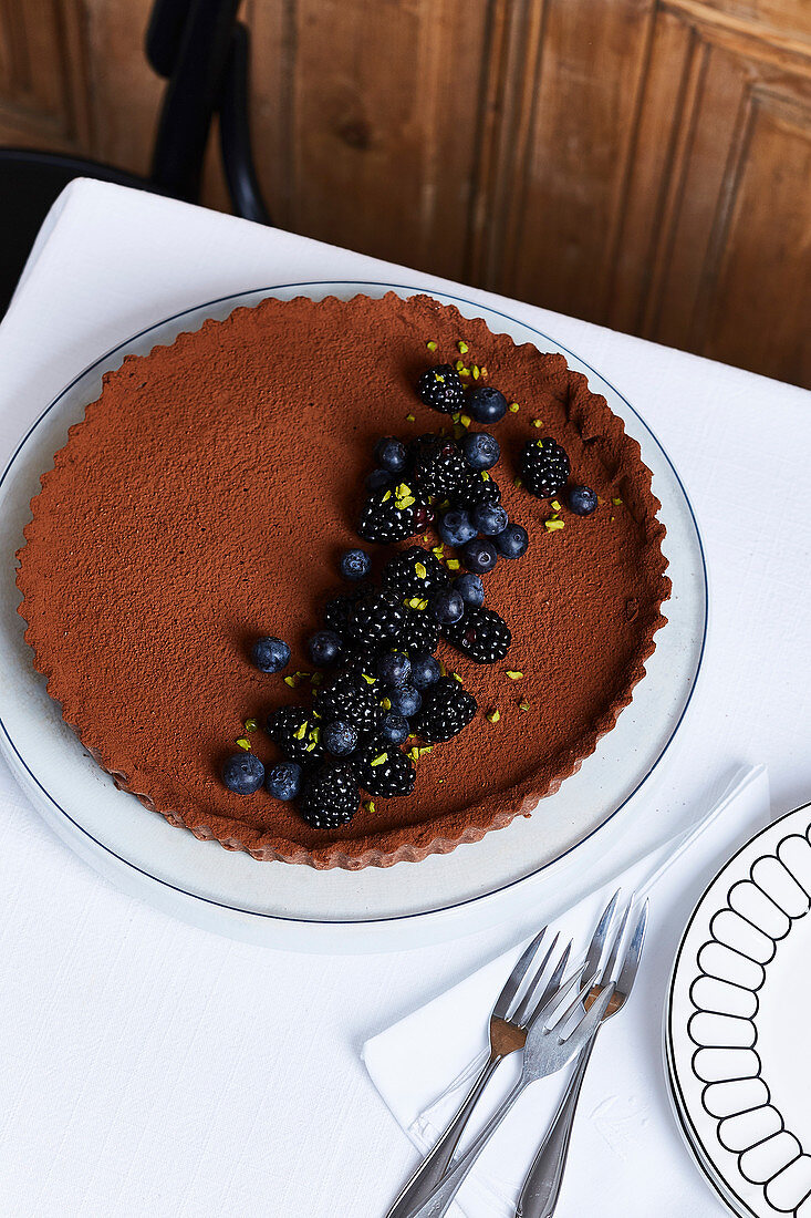 A chocolate tart with blackberries and blueberries
