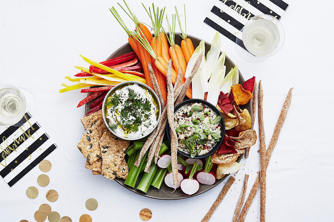 A raw food platter with dips and grissini for New Year's Eve