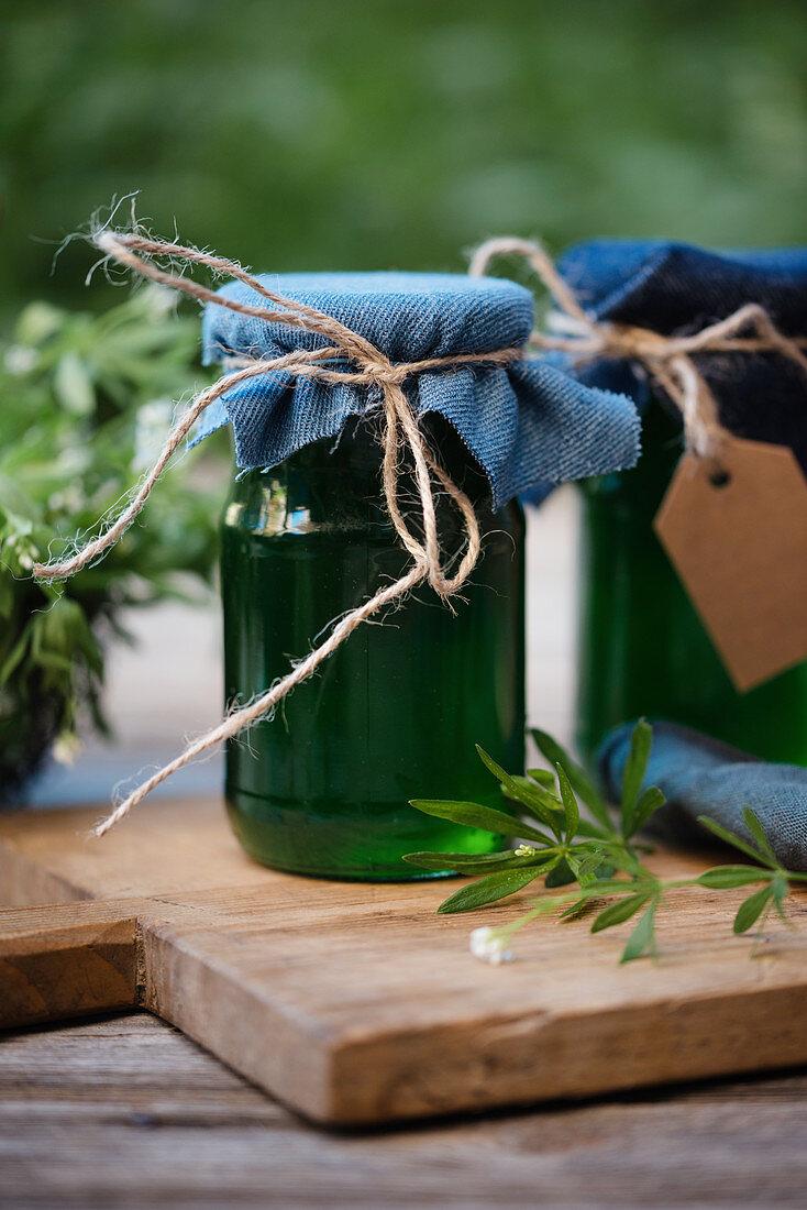 Jars of home-made sweet woodruff jelly