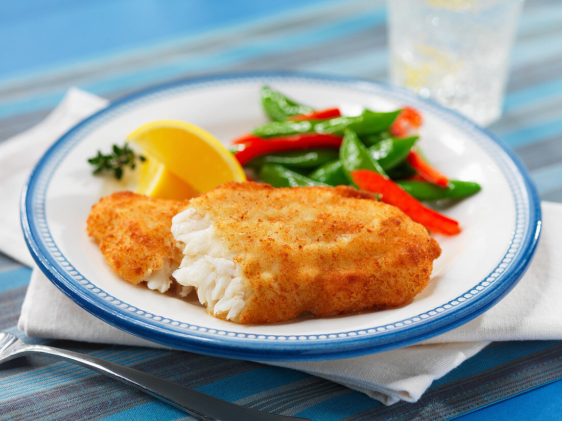 Breaded fish with vegetables