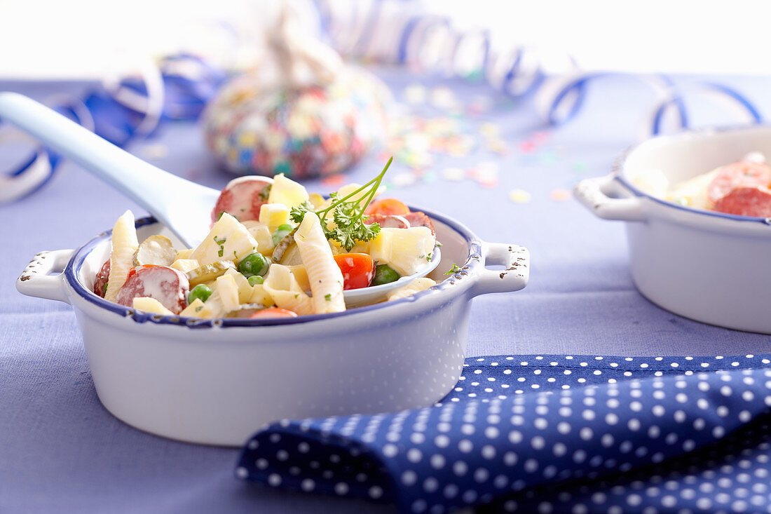 Penne pasta salad with pineapple and mayonnaise-yoghurt dressing in a mini baking dish