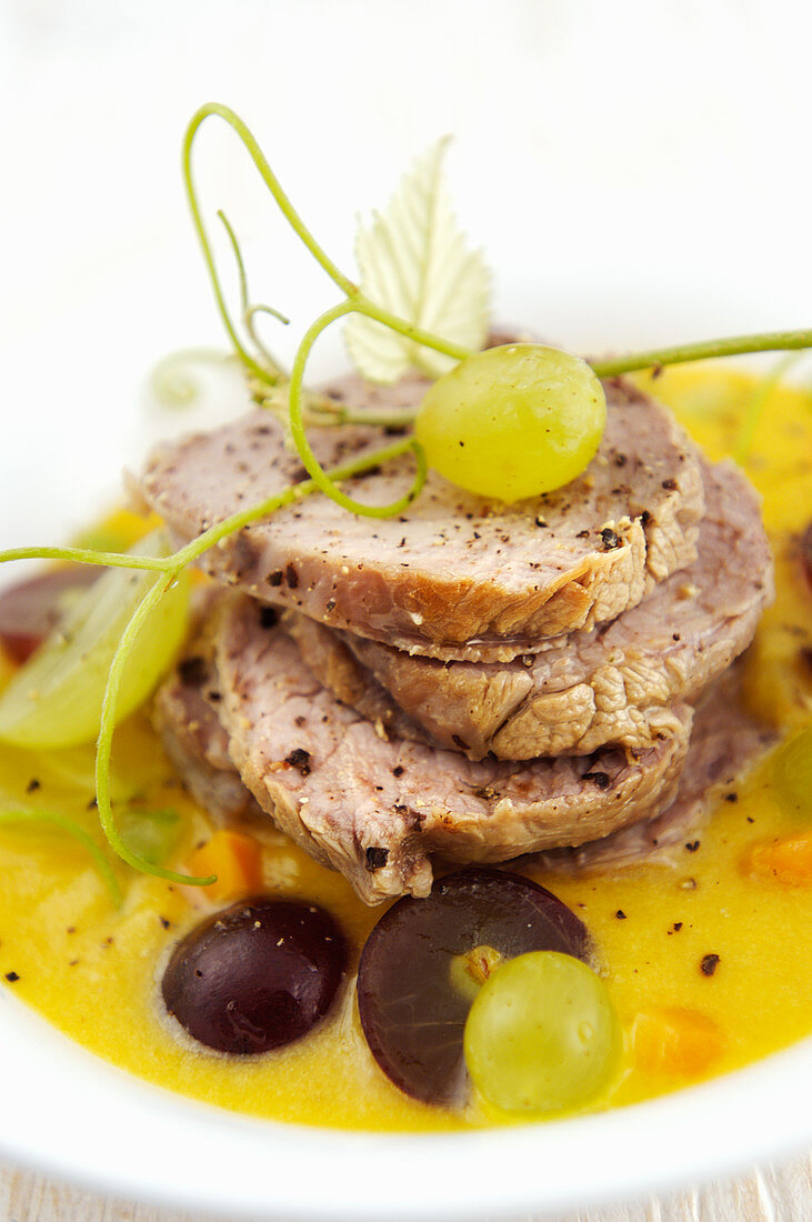 Roast pork in a sweet-and-sour sauce with grapes (Italy)