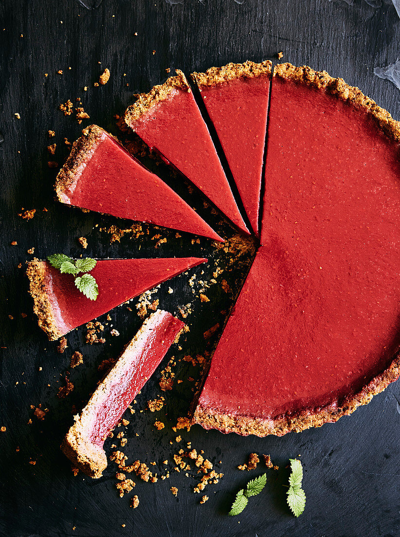 Gluten, dairy free and refined sugar rhubarb and raspberry tart. With a hazelnut, toasted cocnut and gluten free flour base