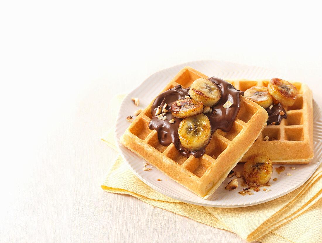 Waffles with hazelnut cream and bananas