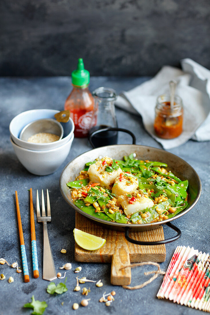 Cod with curried snow peas and chickpeas sprouts