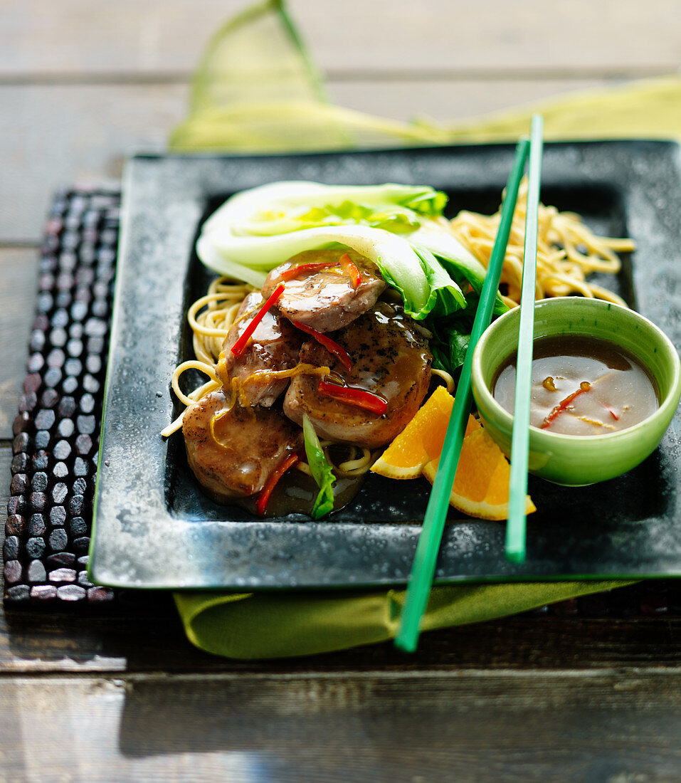 Five spice duck with pak choi, chillies, noodles and oranges (China)