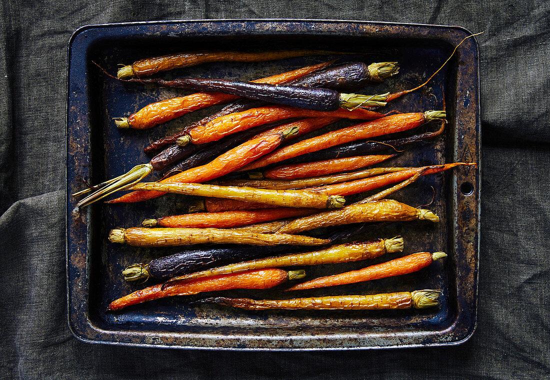 Roasted heirloom carrots on baknig tray